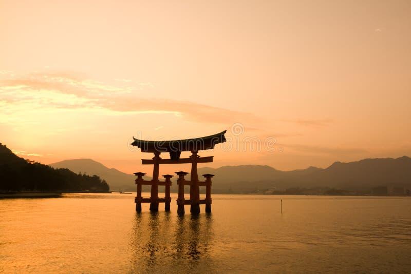 Red Torii gate, Miyajima Island, Japan. Sunset with Red Torii gate on the river of Itsukushima shrine, Miyajima Island, Japan stock photos