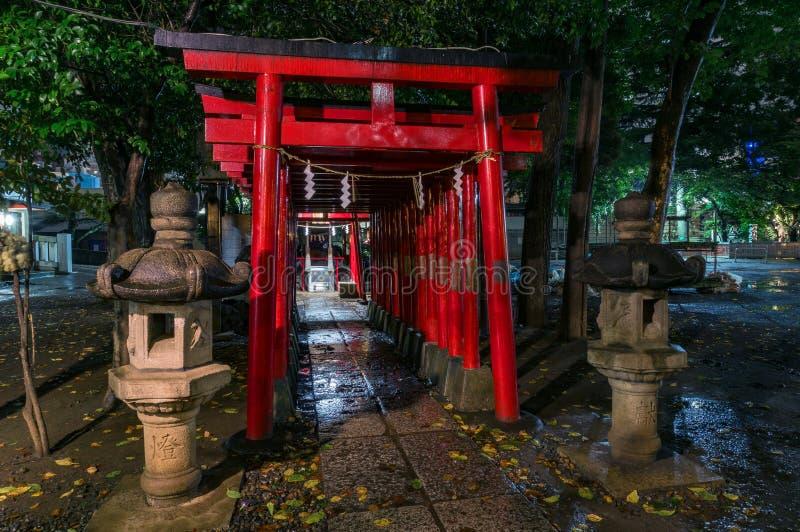 Red Torii gates of Hanazono Shinto shrine, Shinjuku, Tokyo, Japan. Tokyo, Japan - August 29, 2016: Red Torii gates of Hanazono Shinto shrine, Shinjuku, Tokyo royalty free stock images