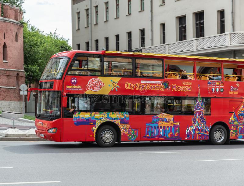 Red Tour bus City Sightseeing on the street in Moscow royalty free stock images