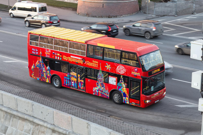 Red tour bus near the Moscow Kremlin stock photo