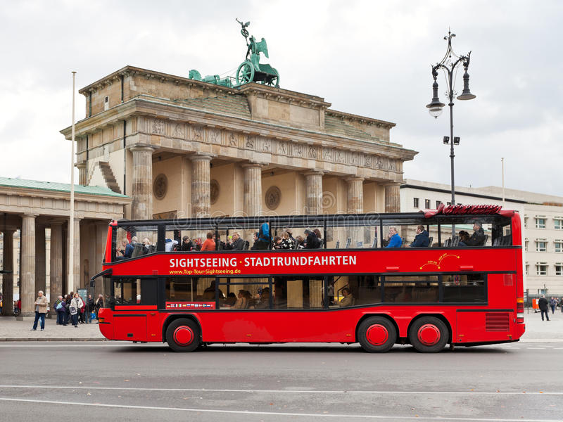 Red tourist double decker bus in Berlin. BERLIN, GERMANY - OCTOBER 17: tourist double decker bus near Brandenburg gate in Berlin on October 17, 2013. The Gate royalty free stock images