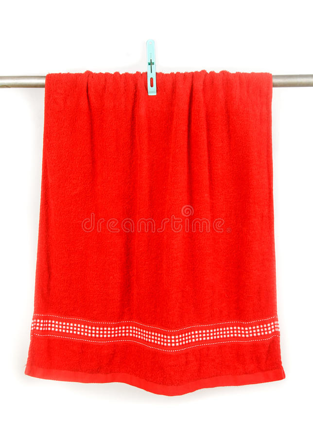 Red towel hang on rack with clip. Isolated on white royalty free stock photo