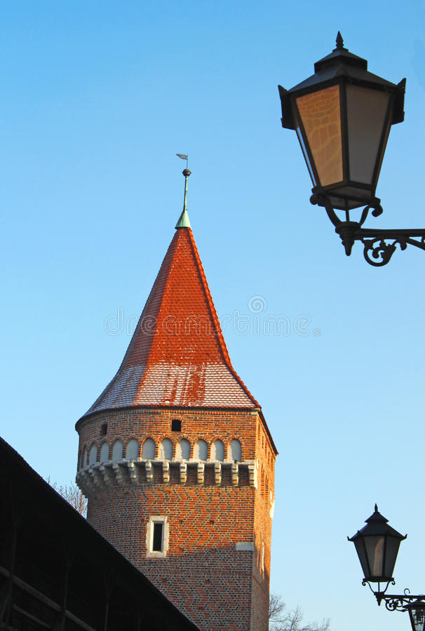 Download Red tower and street lamps stock photo. Image of central - 18301756