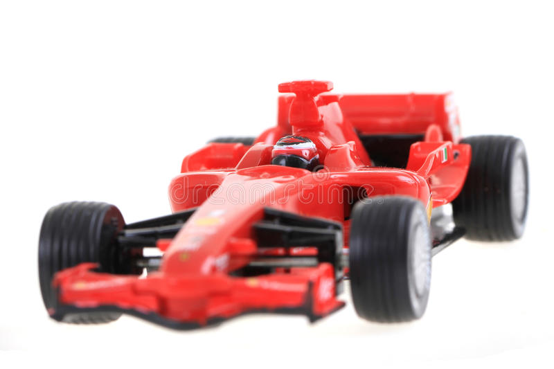 Red toy as formula car. Isolated on the white background stock photography