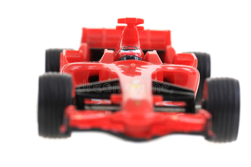 Red toy as formula car. Isolated on the white background royalty free stock photography