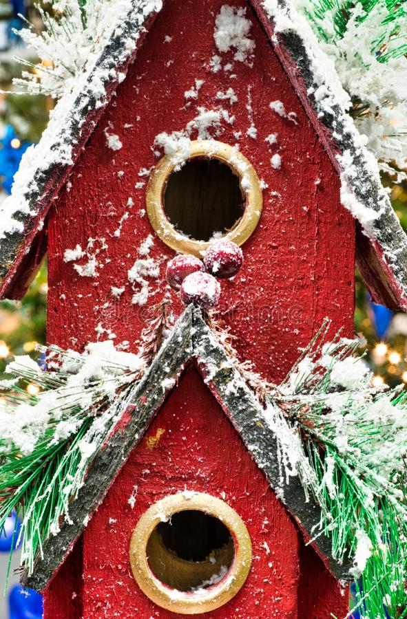 Red toy birdhouse with Christmas theme. royalty free stock photography