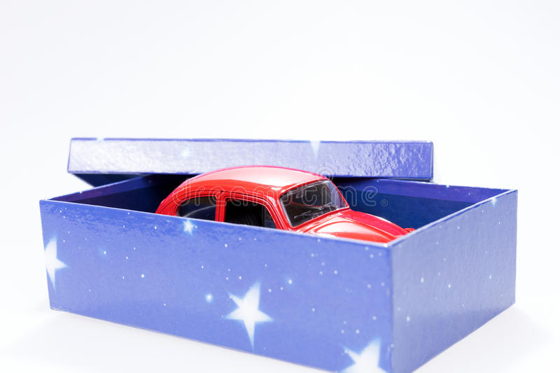 Red toy car in gift box. Red toy car in blue gift box royalty free stock images