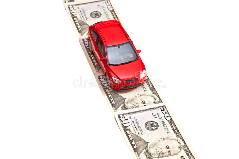 Red toy car on the money road, isolated on white. Toy car on the money road, isolated on white. Rent, buy, repair or insurance car concept royalty free stock photography