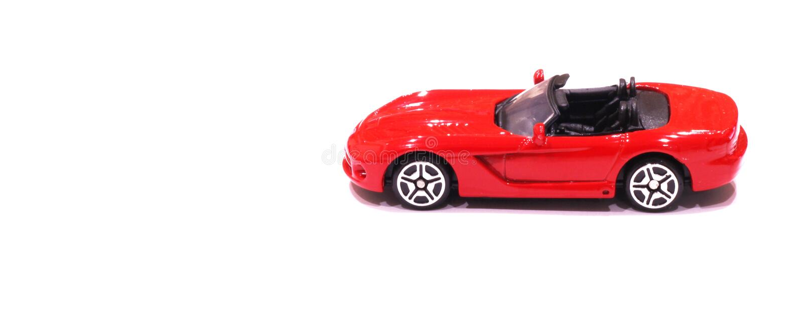 Red toy car with an open top. On a white background stock photos