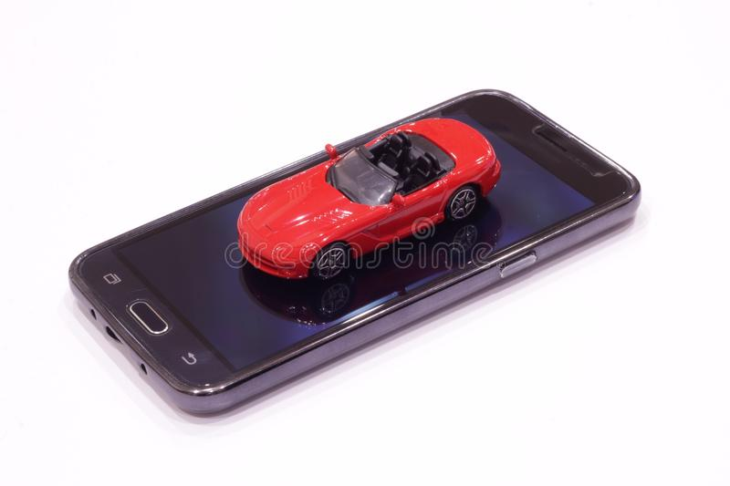 Red toy car with an open top. On a white background royalty free stock photos