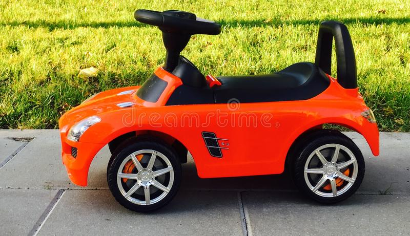 Red toy car. Outdoors for small kid to take a ride royalty free stock photo