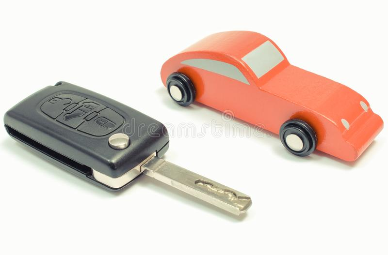 Red toy car and vehicle key on white background stock photos