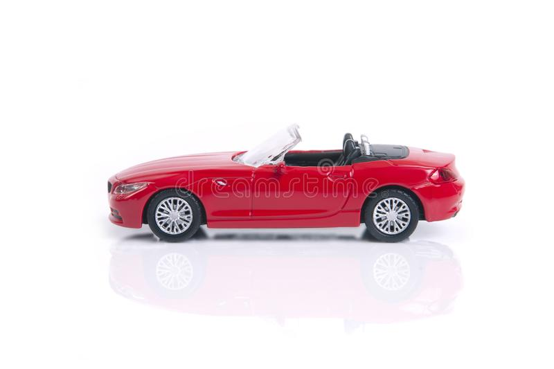 Red toy or model convertible sport car. Red toy or model convertible sport car on white background stock photos