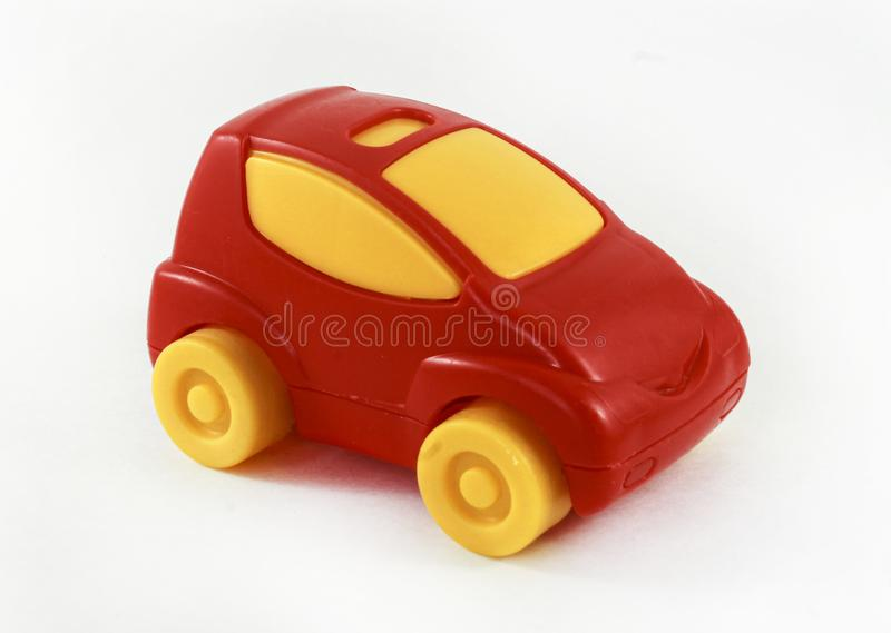 Red toy plastic car with yellow wheels and yellow glasses. Children toy royalty free stock images