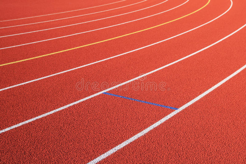 Red track lanes turn stock photography