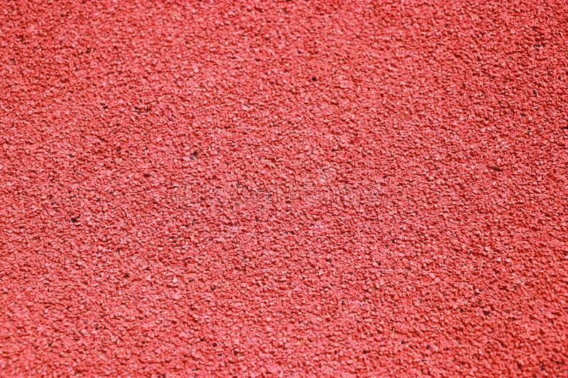 Floor running track,. Red tracks or floor running track, sports field background royalty free stock photos