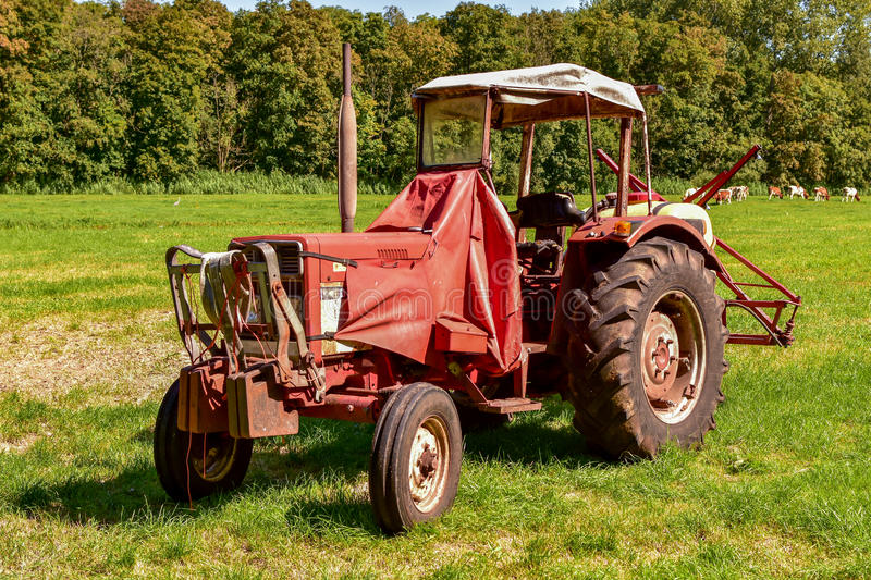 Red old vintage farmers tractor stock photos