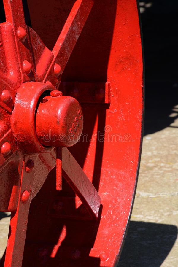 Red tractor wheel detail stock image