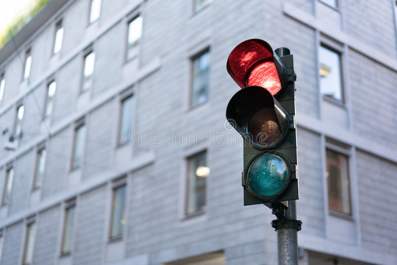 Red Traffic light in downtown with clipping path and copy space. Urban traffic or modern city life concept.  stock images