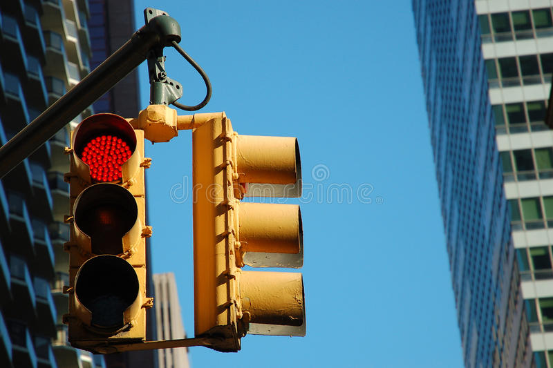 Red traffic light in manhattan stock images