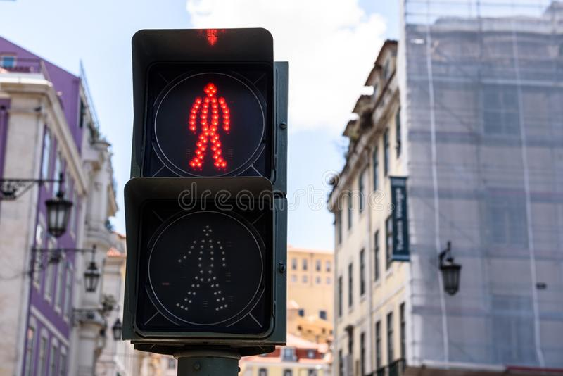 Red traffic light for pedestrian in Lisbon city, Portugal. Traffic light signs red for pedestrian - not allowed to walk. Lisbon city, Portugal royalty free stock photos