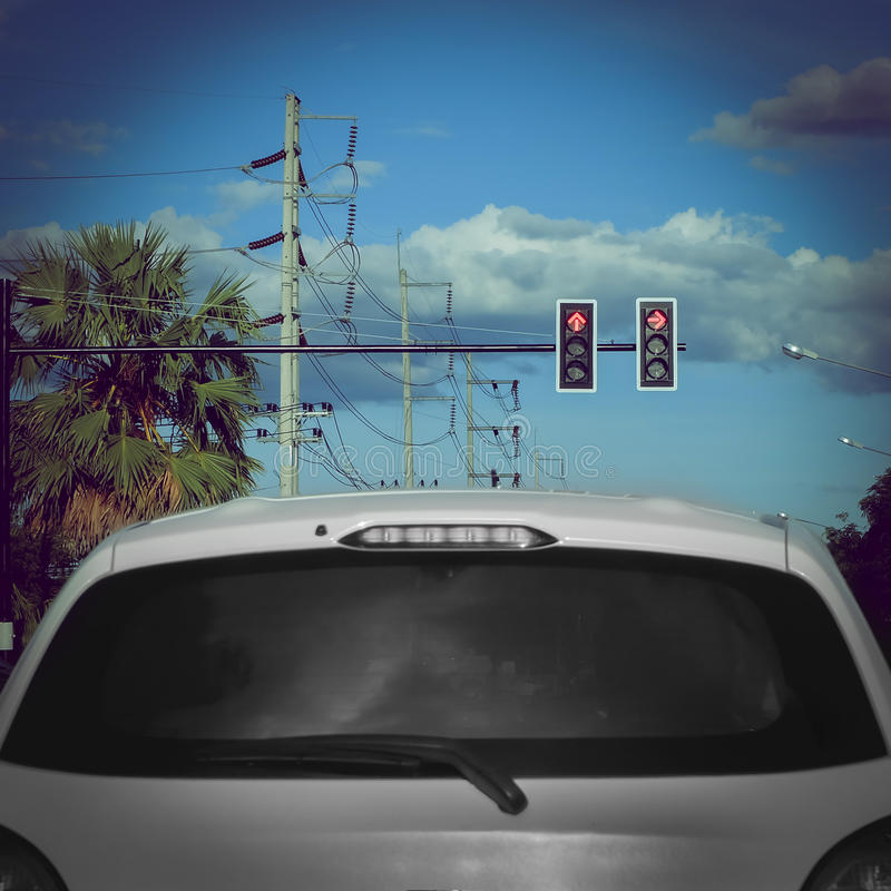 Red traffic light on road with car stop. On street stock image