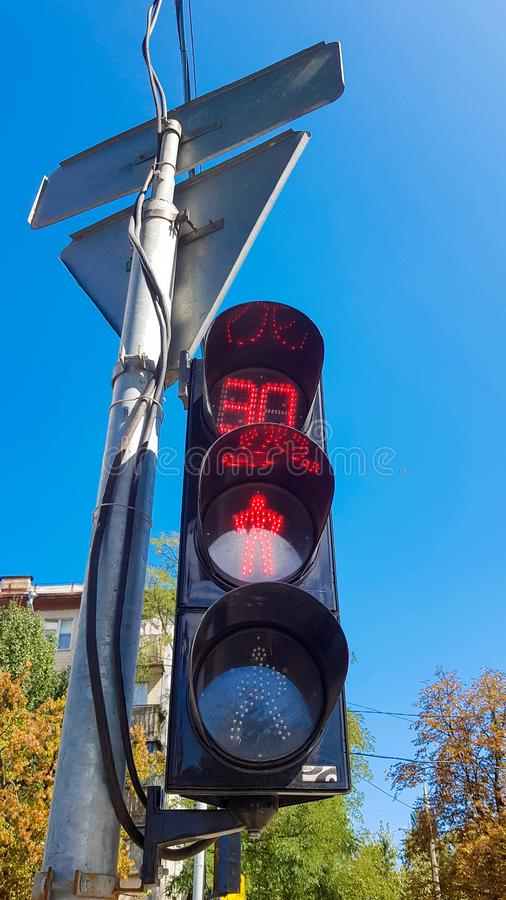 Red traffic light with time delay. Vertical photo. Traffic light on a taxi with a stop signal in the daytime royalty free stock photography