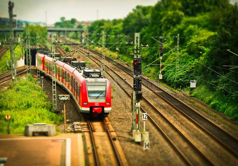 Red Train On Black Train Tracks Near Trees At Daytime Free Public Domain Cc0 Image