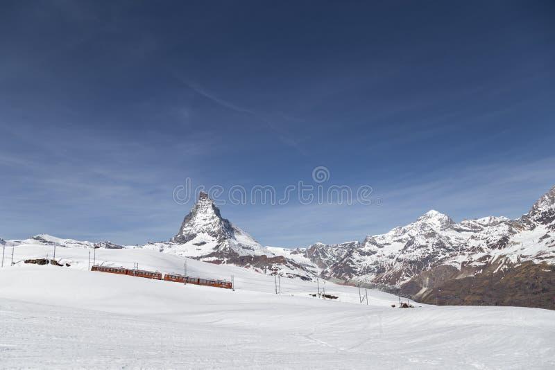 Red Train in front of Matterhorn, Switzerland stock images