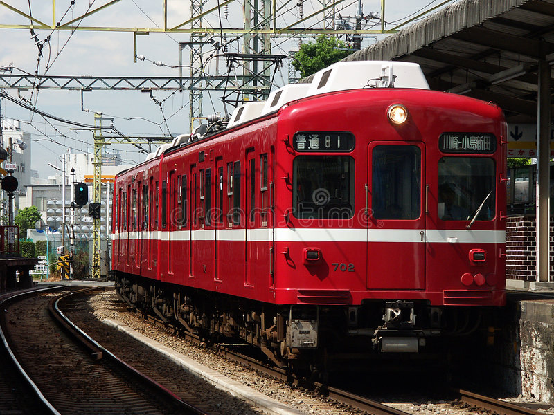 Red Train Kawasaki,Japan. Image of a red train thats operating on the outskirts of Tokyo in Kawasaki,JapanScheds. Trains are everywhere in Japan and they are royalty free stock photos