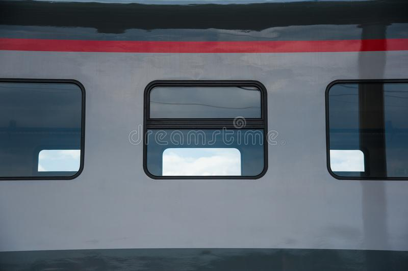 Red train in modern railway. Central station stock image