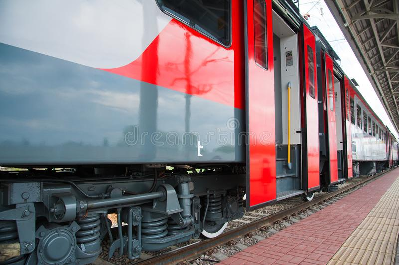 Red train in modern railway. Central station royalty free stock photo