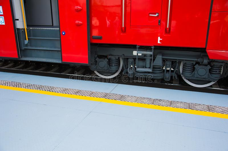 Red train in modern railway. Central station royalty free stock image