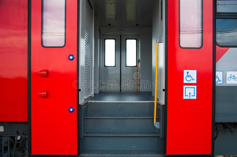 Red train in modern railway. Central station stock photography