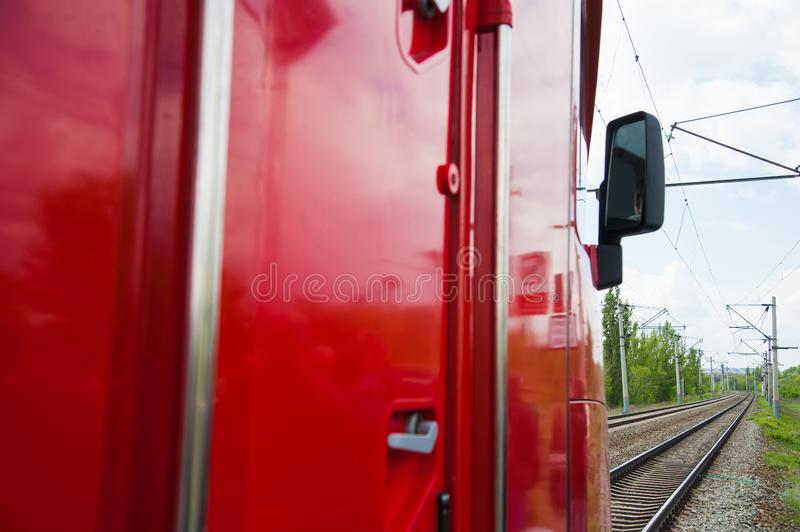 Red train in modern railway. Central station stock photos