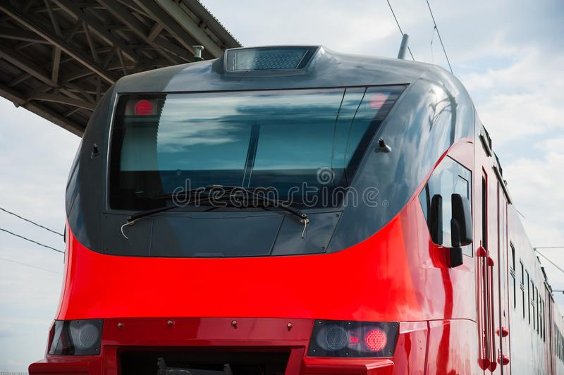 Red train in modern railway. Central station royalty free stock photography