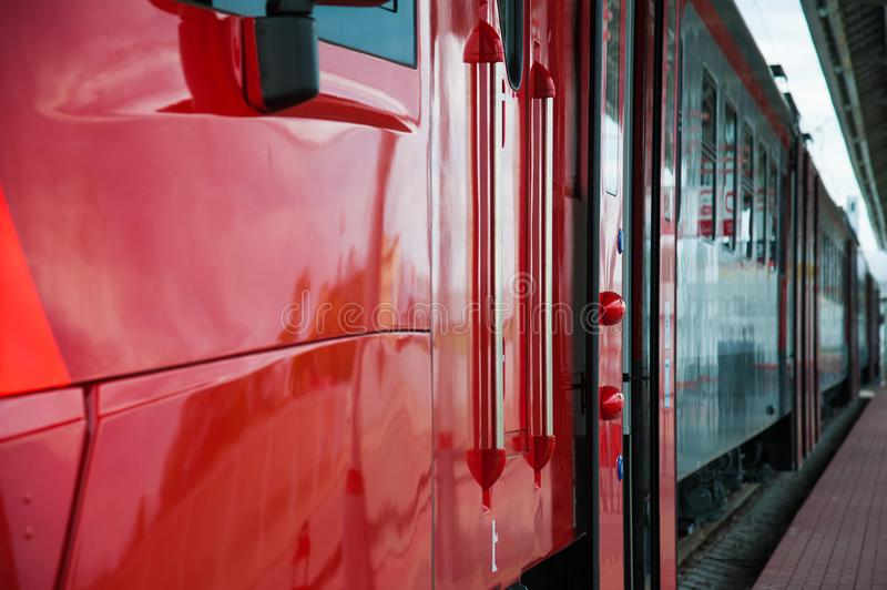 Red train in modern railway. Central station royalty free stock photos