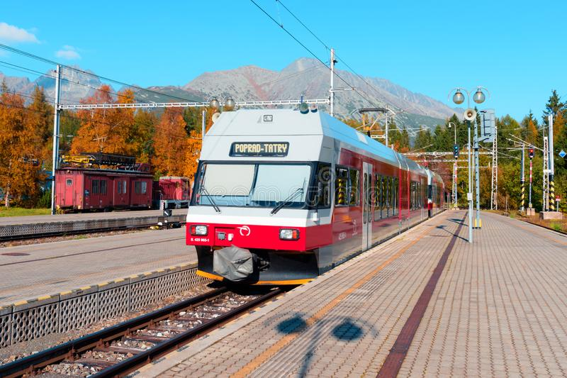 Red train in the Slovak Tatras royalty free stock photography
