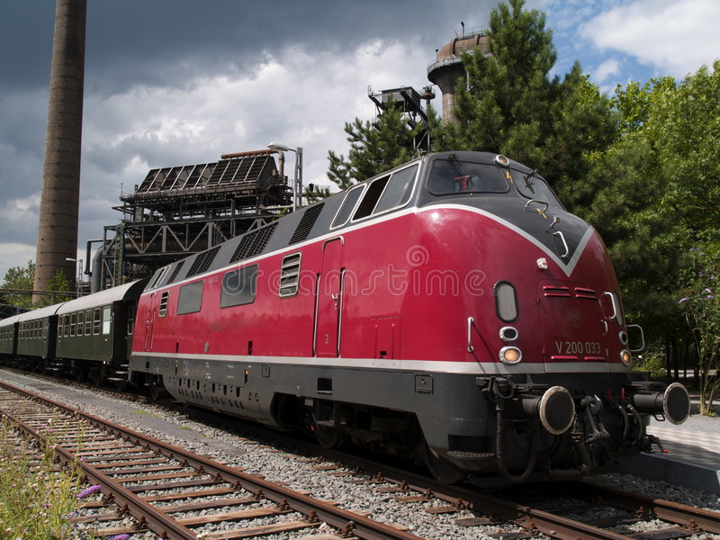 Download Red train on the tracks stock image. Image of grey, gray - 7006341