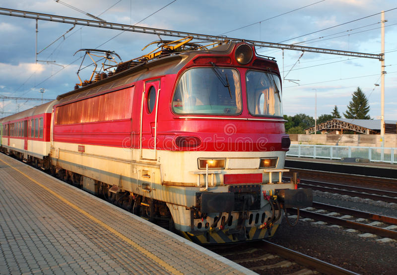 Download Red Train Under Blue Sky. Stock Photos - Image: 20286483