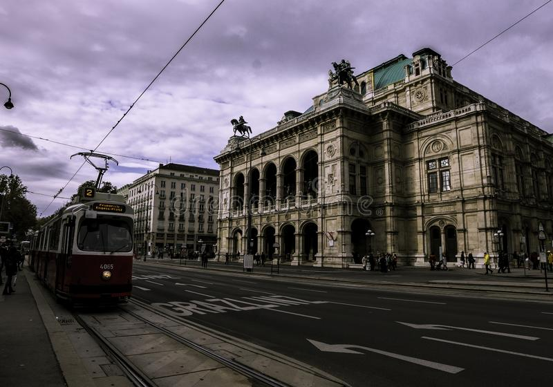Red tram in front of the Vienna Opera royalty free stock images