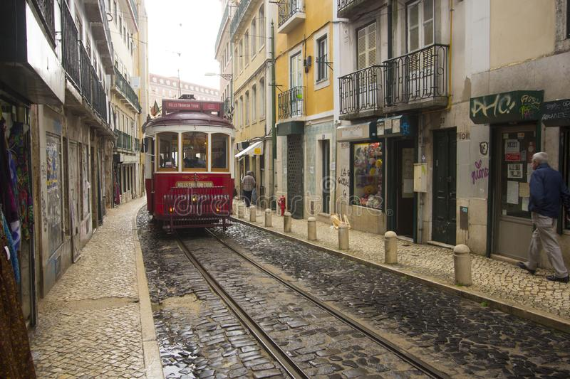 A red tram to the narrow streets of Lisbon royalty free stock image