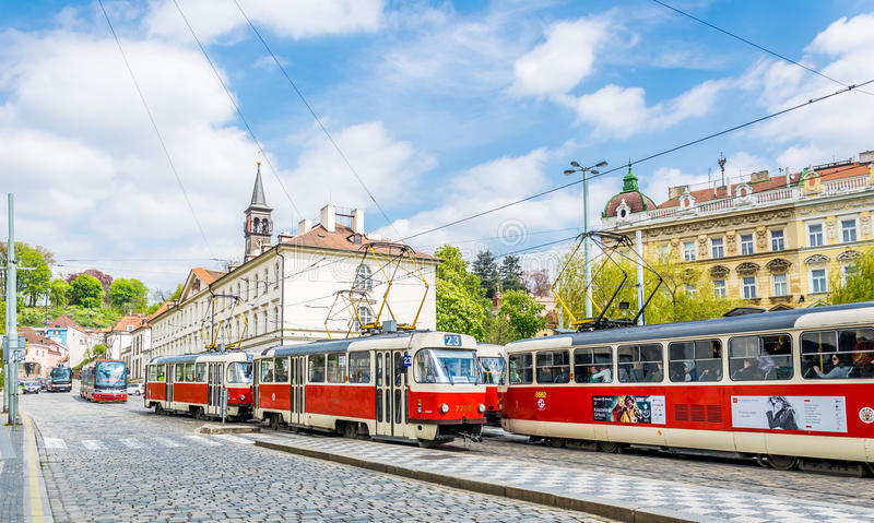 Red trams on the ancient streets of Prague. City Life in Europe stock image