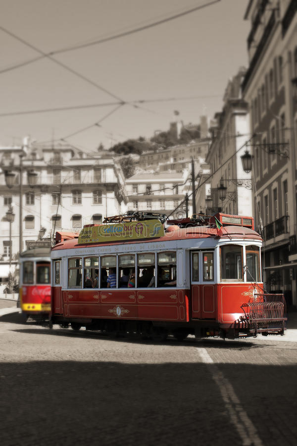 Red Trams circulating in Lisbon, Portugal. Red Trams circulating in the streets of Lisbon, Portugal royalty free stock photos