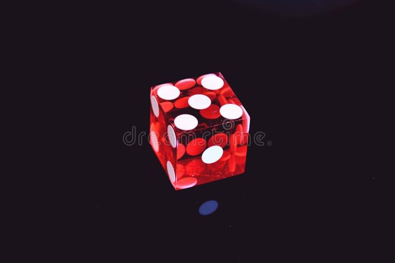 Red Translucent Sterk op het zwarte oppervlak royalty-vrije stock afbeelding