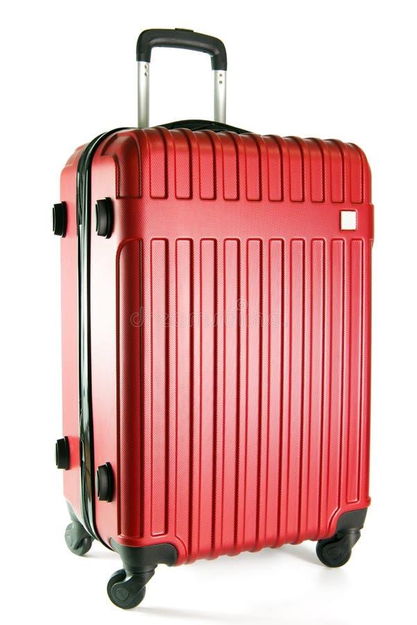Red travel luggage isolated on white background stock photos
