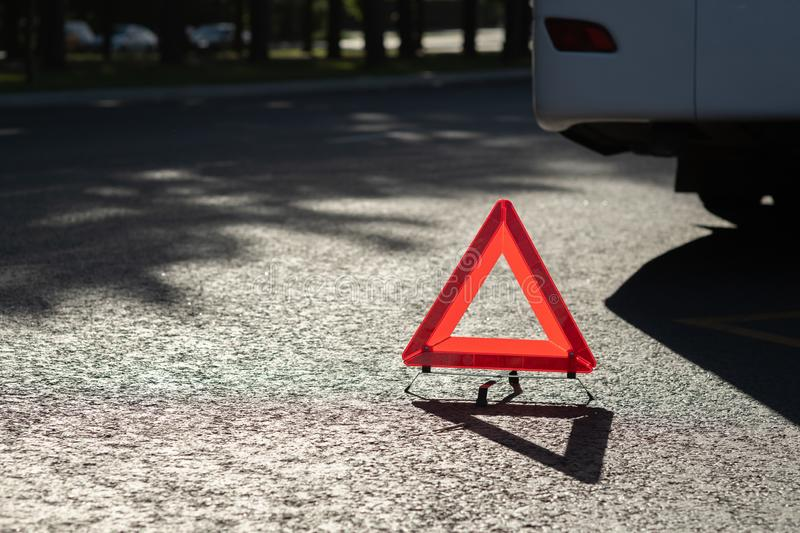 Red triangle of a car on the road. Description: Red triangle of a car on the road, sign, emergency, accident, warning, traffic, automobile, danger, engine stock image