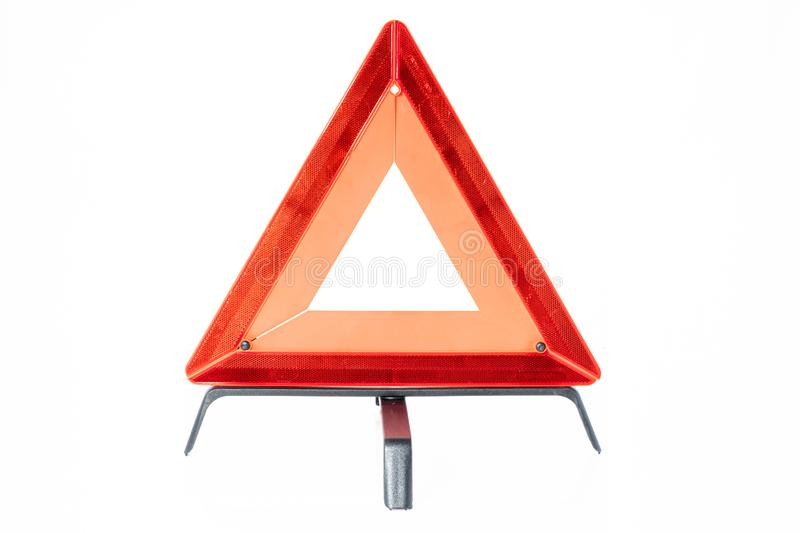 Red triangle of danger for emergencies of car broken down on road only with white background. Safety stock photos