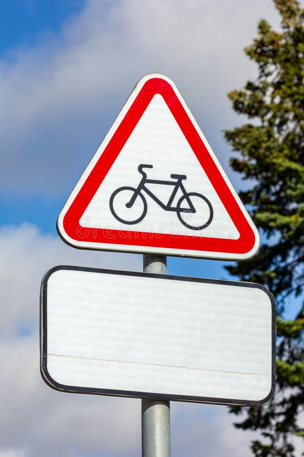 The red triangle sign prohibiting the entry of cyclists against the blue sky. The red triangle sign prohibiting the entry of cyclists against the blue sky stock photography