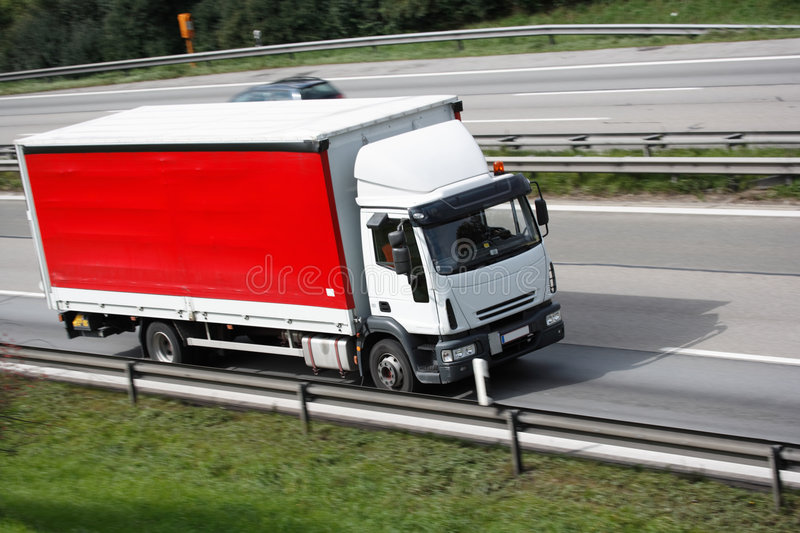 Red truck. With slight motion blur royalty free stock photography
